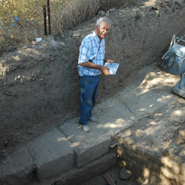 Denis Knoepfler standing on the foundations of the stoa (2007)